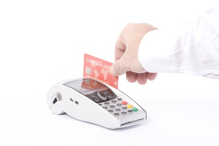 swipe: Hand with credit card swipe through terminal for sale