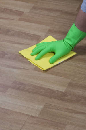 cleaning with a piece of cloth on wooden parquet photo