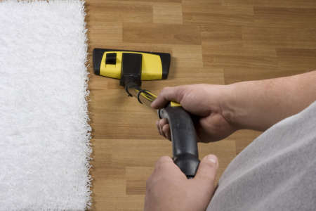 Vacuum cleaner on the carpet Stock Photo - 12535204
