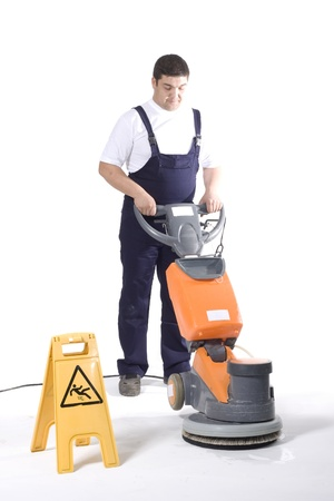 working machines: cleaning floor with machine Stock Photo
