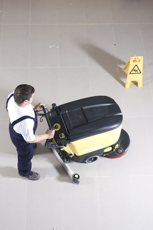 cleaning equipment: cleaning floor with machine Stock Photo