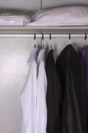 modern wardrobe with clothes photo
