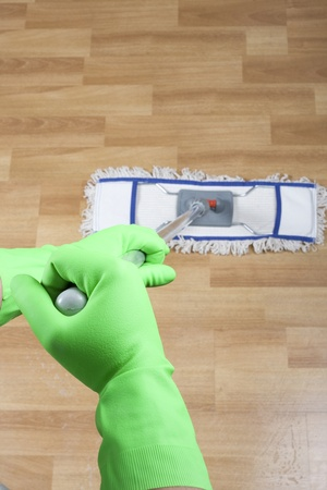 cleaner is mopping wooden parquet floor photo