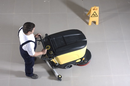 floor cleaning: cleaning floor with machine Stock Photo