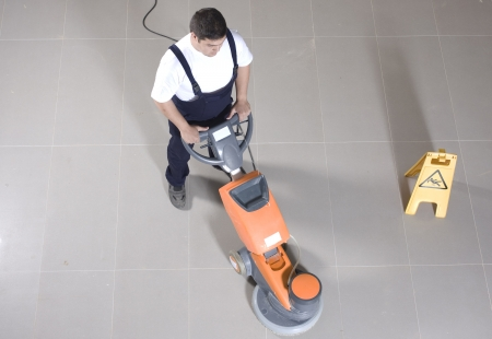 polisher: cleaning floor with machine Stock Photo