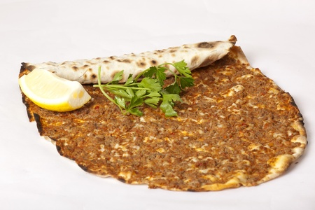 tomatto:  Delicious Turkish pizza lahmacun on isolated background