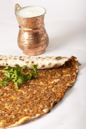 Delicious Turkish pizza lahmacun on isolated background photo