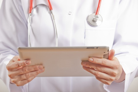 a woman doctor holding a tablet pc