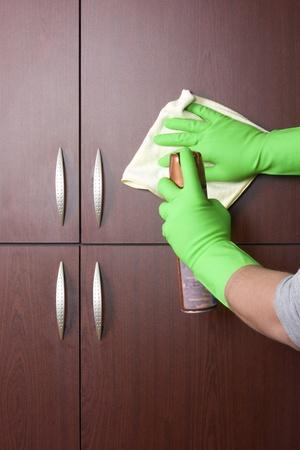closet door:  cleaner hand polishing the door of closet
