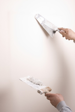 patching: Putty Knife with Paste to Repair Wall Damage Stock Photo