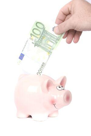 nestegg: Piggy bank on white with euro