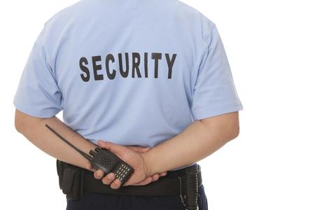 guarda de seguridad: Guardia de seguridad mano que sostiene CB walkie-talkie de radio Foto de archivo