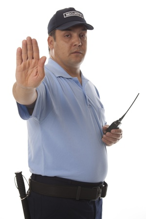 hand guard:  A security guard holding out his hand, isolated on white Stock Photo