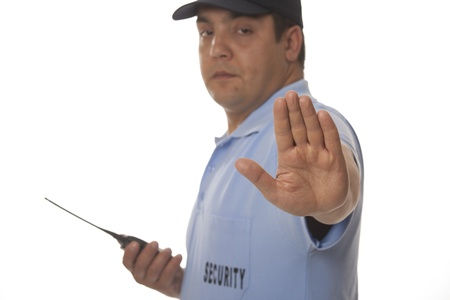security laws:  A security guard holding out his hand, isolated on white Stock Photo
