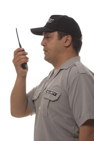 seguridad en el trabajo: Guardia de seguridad mano que sostiene CB walkie-talkie de radio Foto de archivo