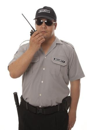 seguridad laboral: Guardia de seguridad mano que sostiene CB walkie-talkie de radio Foto de archivo