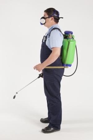 El hombre rociado insectos, control de plagas