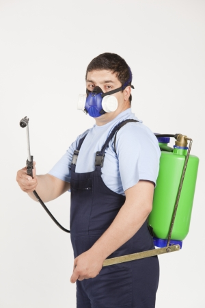 Man spraying insects- pest control Stock Photo - 13478842