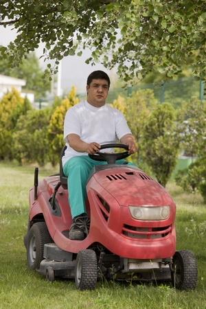 Ride-on lawn mower cutting grass photo