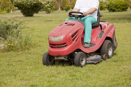 garden tool: Ride-on lawn mower cutting grass