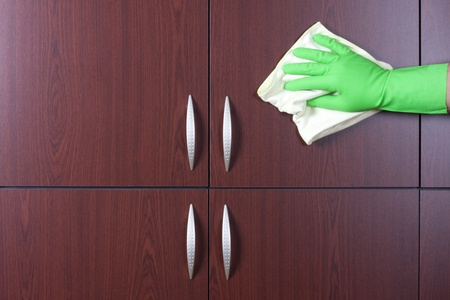cleaner hand polishing the door of closet Stock Photo - 13838189