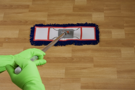 light duty: cleaner is mopping floor