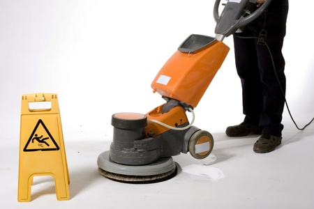 polishing:  cleaning floor with machine
