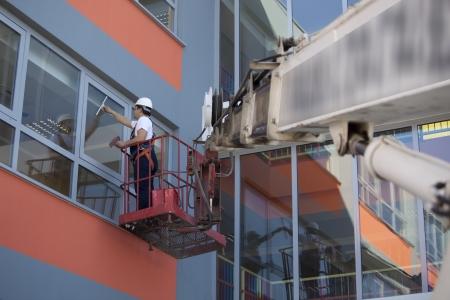 cleaning window glass Фото со стока