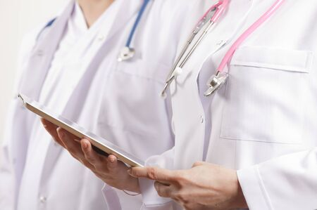 doctor using tablet pc photo