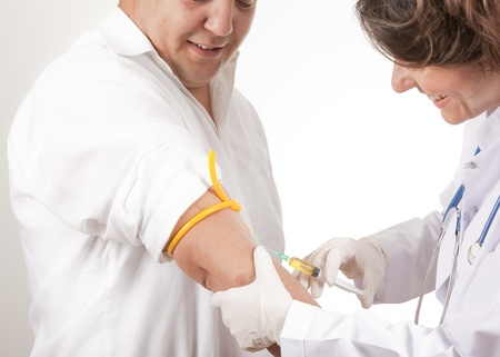 doctor hold an injection photo