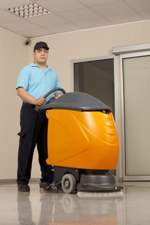 cleaning floor with machine Фото со стока
