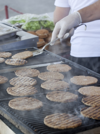 hot grill: Hamburgers being cooked on the hot grill
