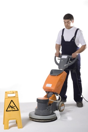 cleaning an office:  cleaning floor with machine