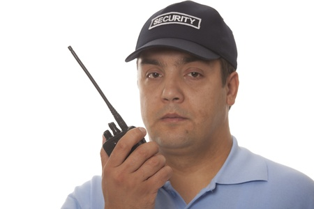 hand guard:  Security guard hand holding cb walkie-talkie radio
