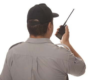 walkie:  Security guard hand holding cb walkie-talkie radio