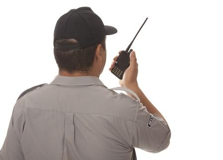Security guard hand holding cb walkie-talkie radio Standard-Bild
