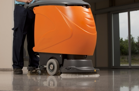man machine:  cleaning floor with machine
