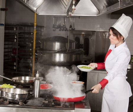 female chef cooking vegetables