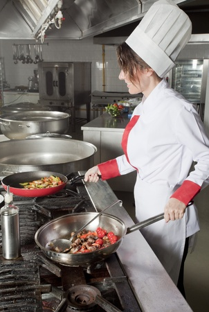 female chef cooking vegetables Stock Photo - 14474239