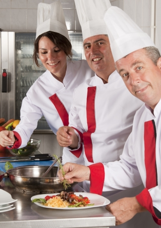 group of young beautiful professional chefs portrait  photo