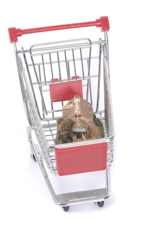 shopping cart trolley with house isolated on white Stock Photo - 15183631