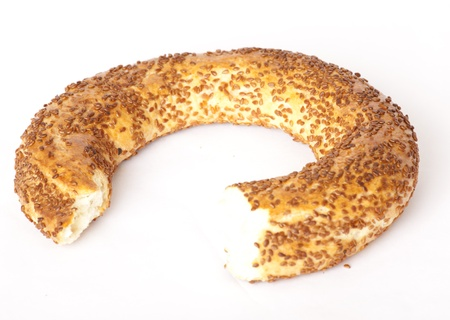 The Turkish bagel strewed by sesame seeds on white background photo