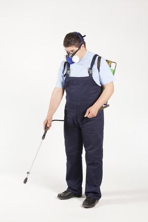 Mann Sprühen Insekten- Schädlingsbekämpfung Lizenzfreie Bilder