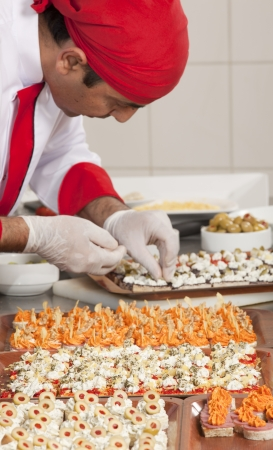 garnishing:  chef garnishing canapes