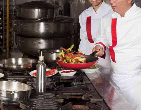 Two chefs at work in a restaurant  photo