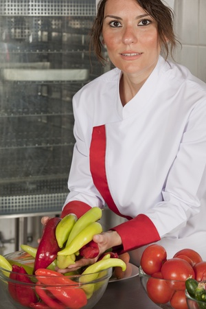 portrait of mid adult female chef in kitchen photo