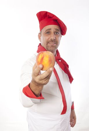 portrait of chef offering peach photo