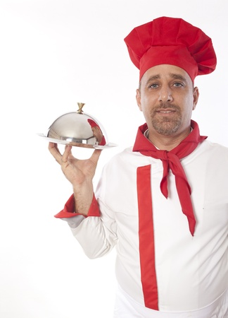 chef with metal cloche lid cover and tray  photo