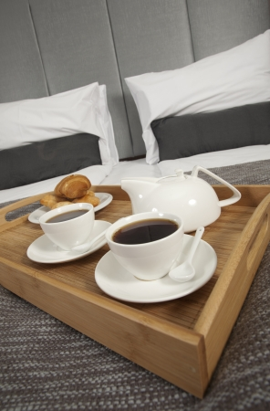 accommodation:  Tray with coffee on a bed in a hotel room