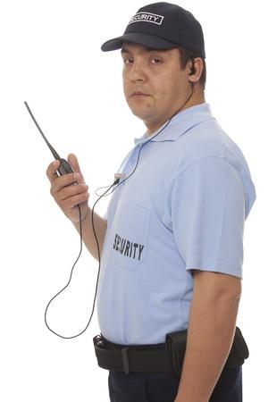 sicurezza sul lavoro: Servizio di sicurezza mano che tiene cb radio walkie-talkie